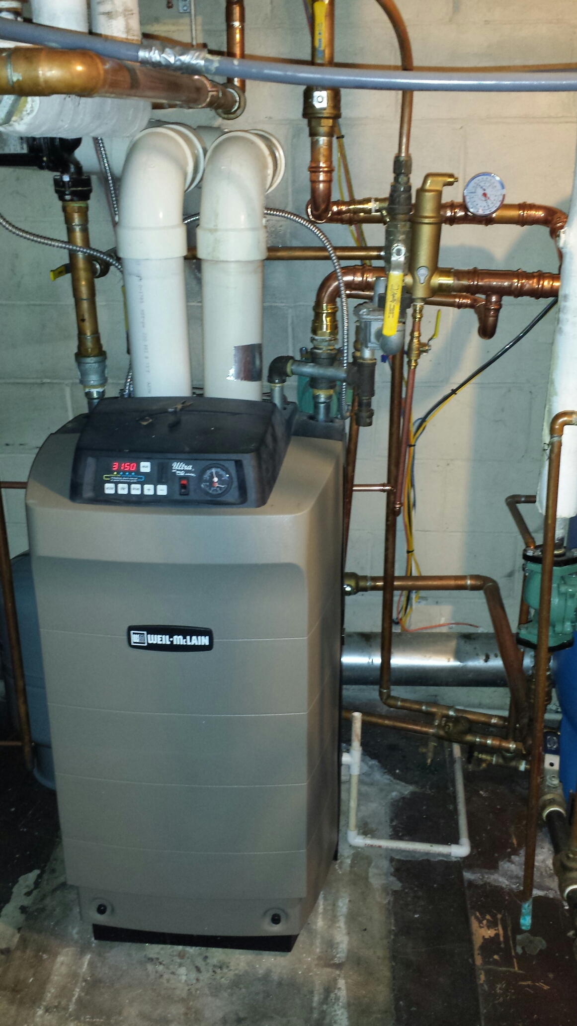 Wayzata, MN - Heating service. Replaced a gasket and insulation kit on a Weil-McLain boiler.
