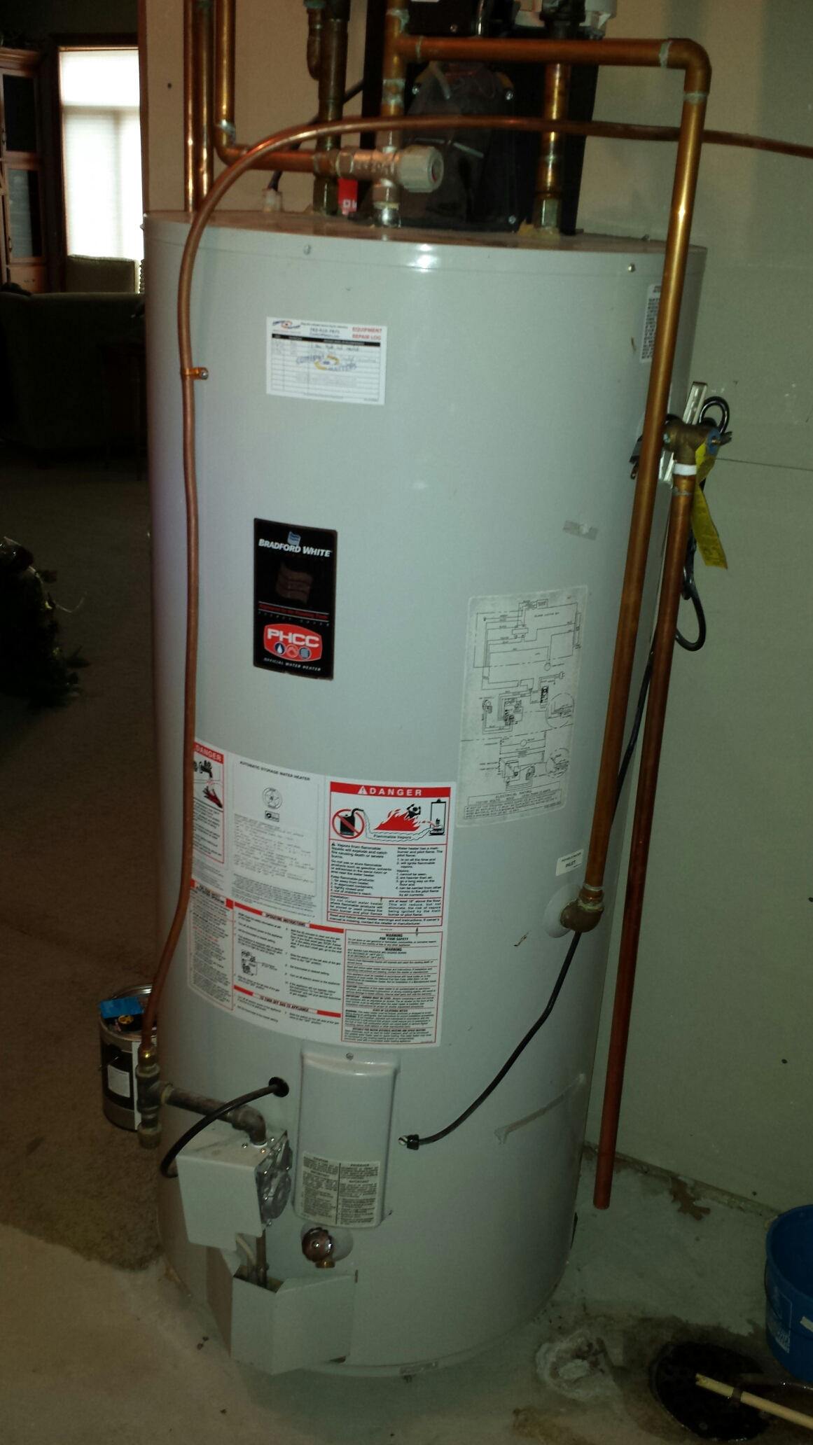 Ramsey, MN - Heating service. Diagnosed a minor leak on a Bradford-White water heater and performed a water heater drain down and flush.