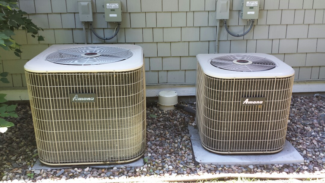 Wayzata, MN - Air conditioner maintenance. Performed a cleaning and tune up on two Amana air conditioners, also replaced two Honeywell media filters.