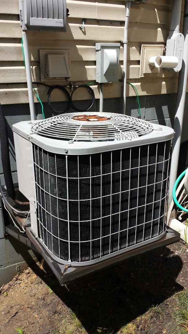 Watertown, MN - Ac service. Replaced a motor booster and performed a tune up on a Carrier air conditioner.