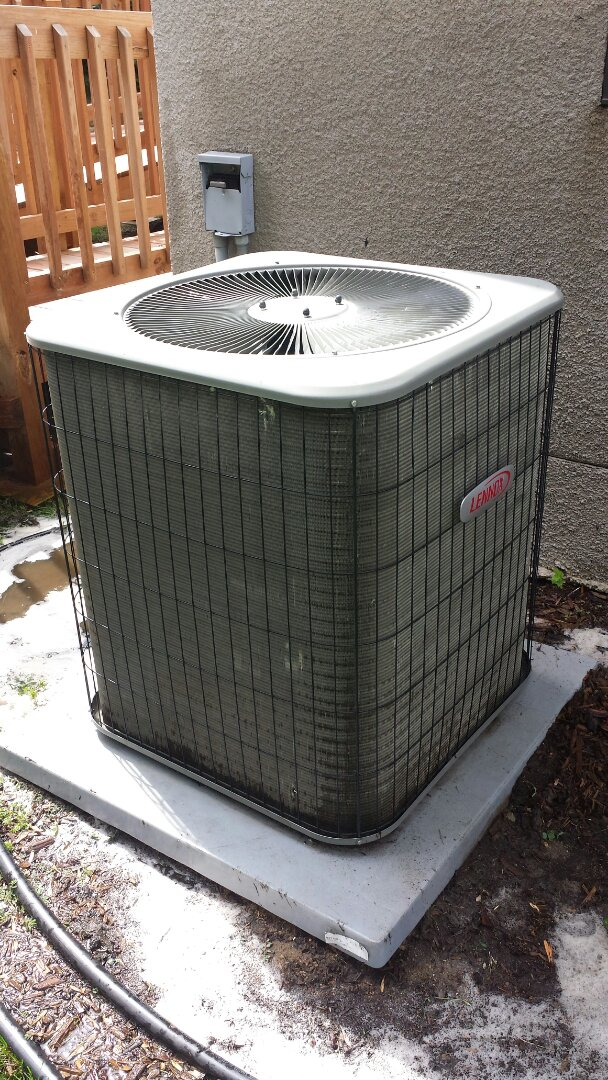 Edina, MN - Air conditioning service. Replaced a condensor fan motor and capacitor on a Lennox air conditioner. Also performed a cleaning and AC tune up.