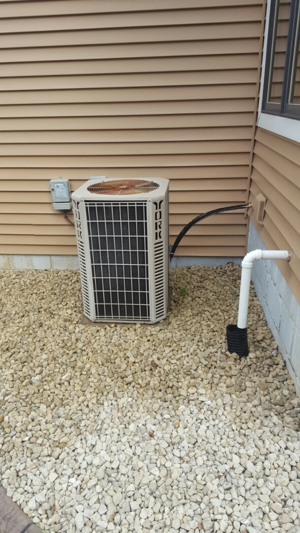 Wayzata, MN - Air conditioning service. Replaced a capacitor and performed a cleaning and tune up on a York A/C