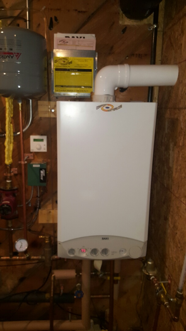 Golden Valley, MN - Boiler maintenance. Performed a cleaning and tune up on a Baxi boiler. Also repaired a leaking PEX connection.