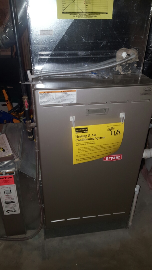Medina, MN - Heating service. Performed a cleaning and tune up on a Bryant furnace and an Aprilaire humidifier.