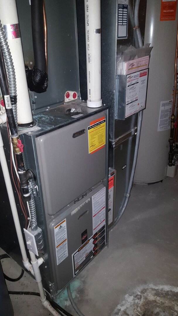 Rockford, MN - Heating service. Installed a new Honeywell thermostat on a Weather King furnace.