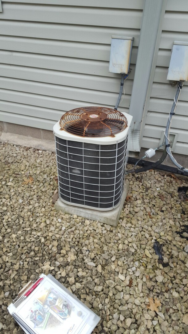 Coon Rapids, MN - Air conditioning service. Installed A/C leak sealant and R-22 refrigerant.