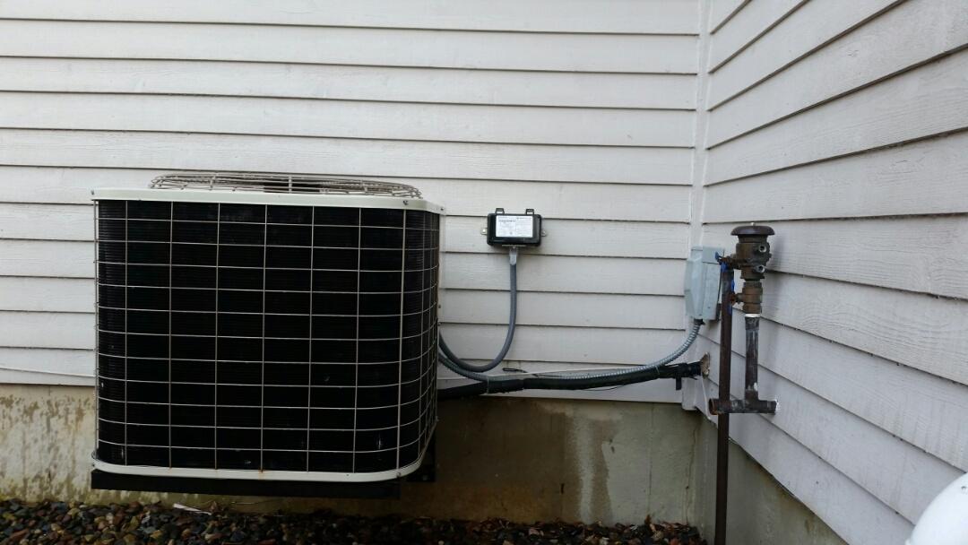 Medina, MN - Air condition maintenance on Bryant Unit.