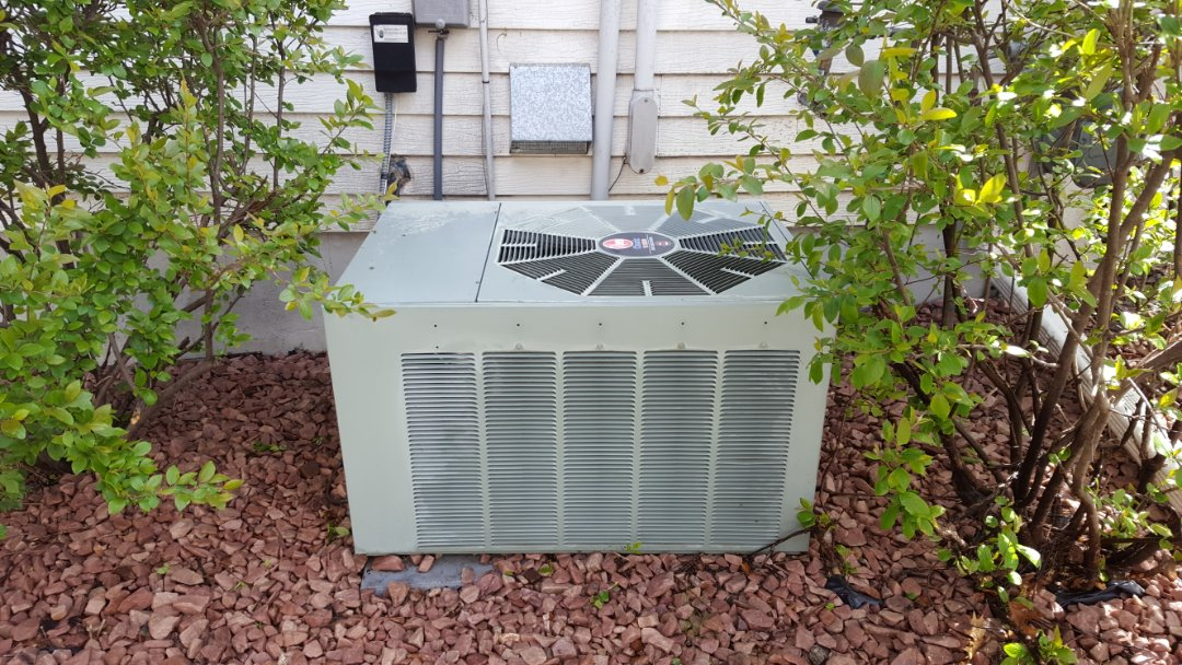Plymouth, MN - Air conditioner maintenance. Performed a cleaning and tune up on a Rheem A.C.