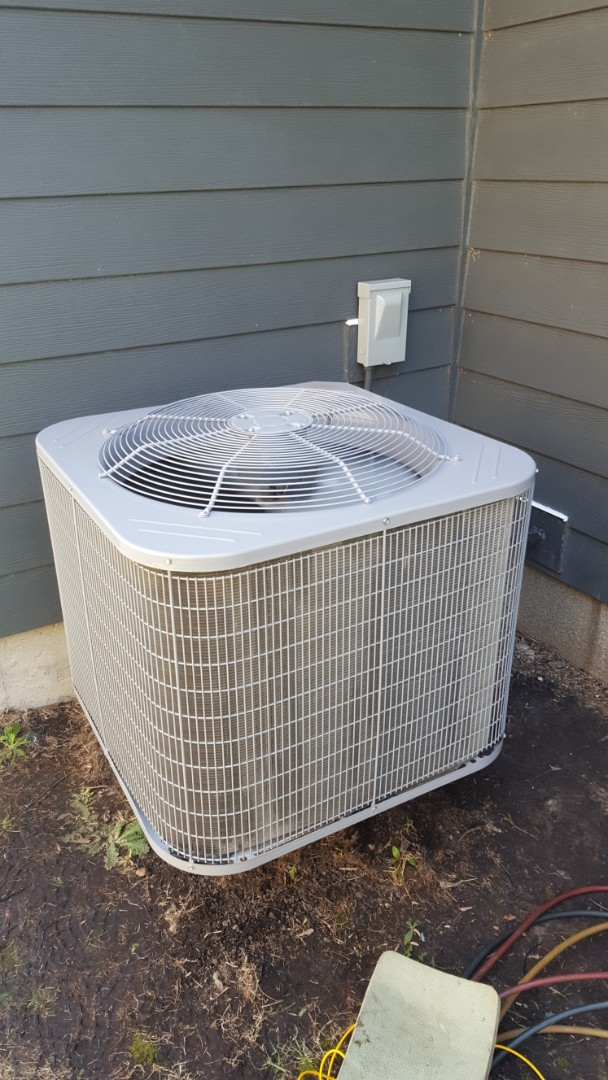 Plymouth, MN - Air conditioning service. Installed a compressor, contactor, and capacitor on a Carrier A/C.