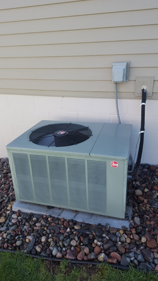 Rogers, MN - AC maintenance. Performed a cleaning and tune up on Rheem air conditioner.