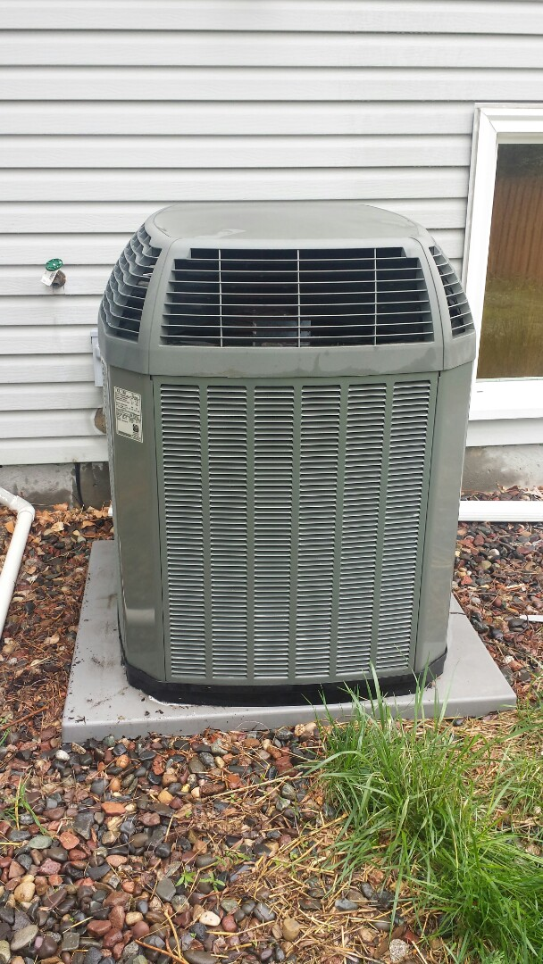 Osseo, MN - Spring maintenance call. Performed tune up and cleaning on Trane air conditioner
