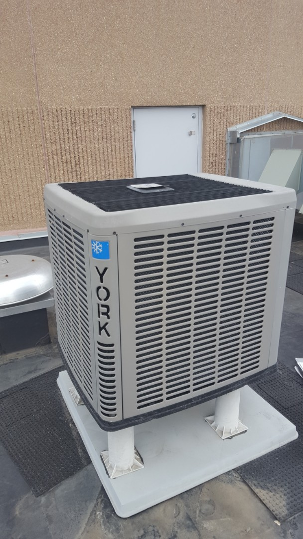 Buffalo, MN - Commercial air conditioner service. Installed R410a refrigerant and A/C leak sealant on a York heat pump.