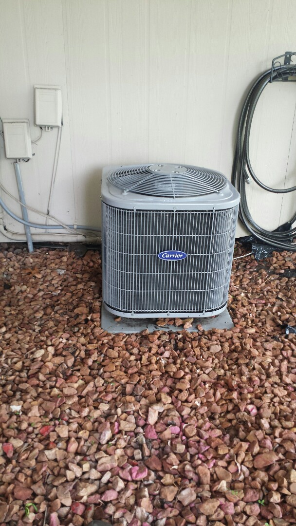 Osseo, MN - Spring maintenance call. Performed tune up and cleaning on Carrier air conditioner