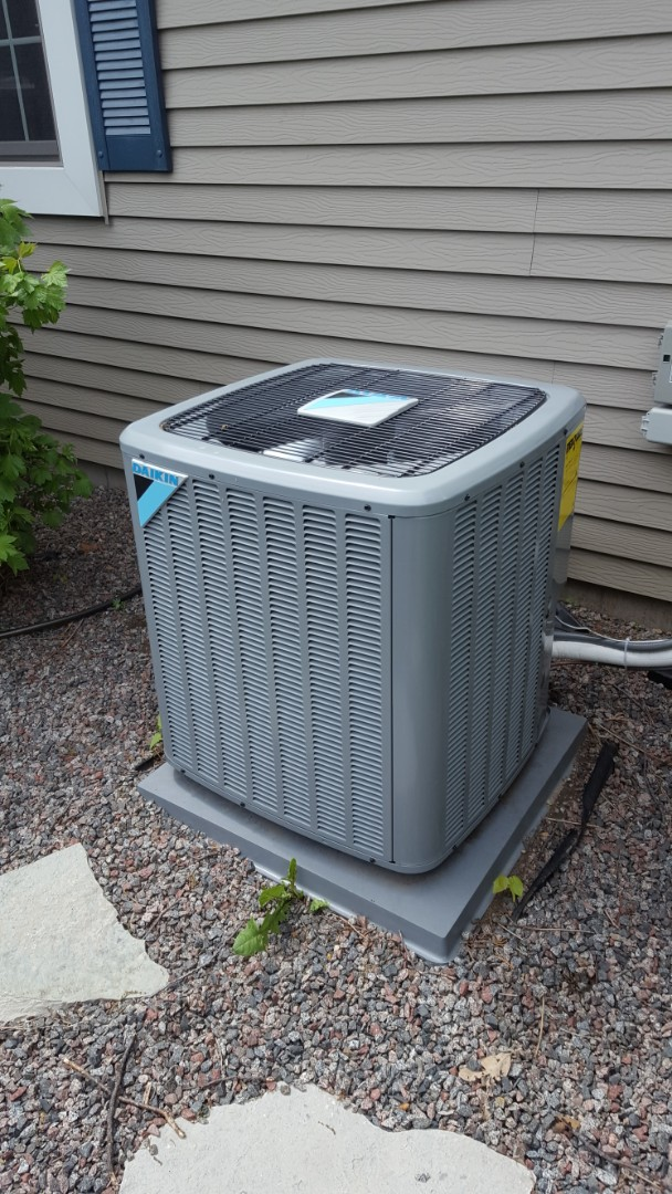 Albertville, MN - Air conditioner maintenance. Performed a cleaning and tune up on Daikin 2 stage A/C. Also installed a surge protector on the A.C. and ECM variable speed blower motor.