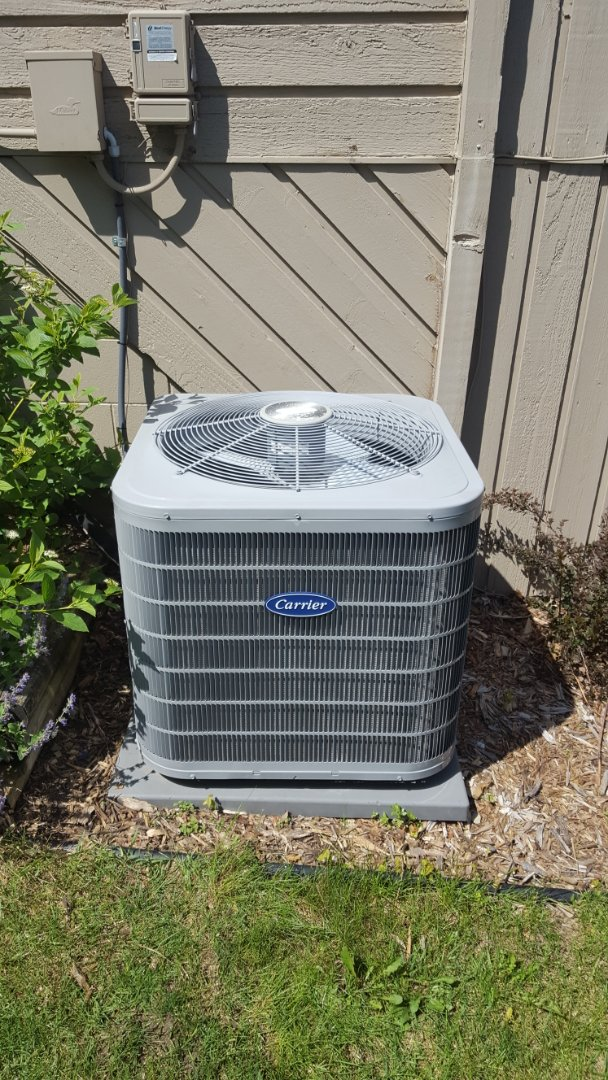 Osseo, MN - Cooling warranty service. Installed a capacitor on a Carrier AC.