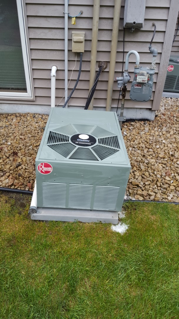 Osseo, MN - Cooling maintenance. Performed a cleaning and tune up on Rheem air conditioner.