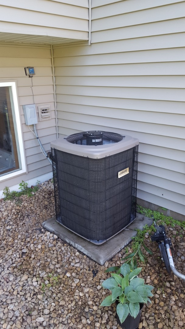 Buffalo, MN - Air conditioning service. Performed a cleaning and tune up, installed a.c. leak sealant, locking refrigerant caps and R-22 refrigerant on a Luxaire Air conditioner.