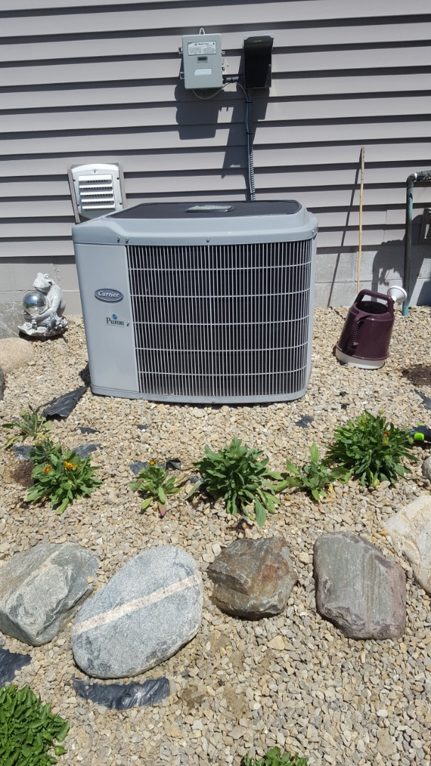 Hanover, MN - Air conditioner service. Installed a capacitor and repaired wiring on a Carrier AC.