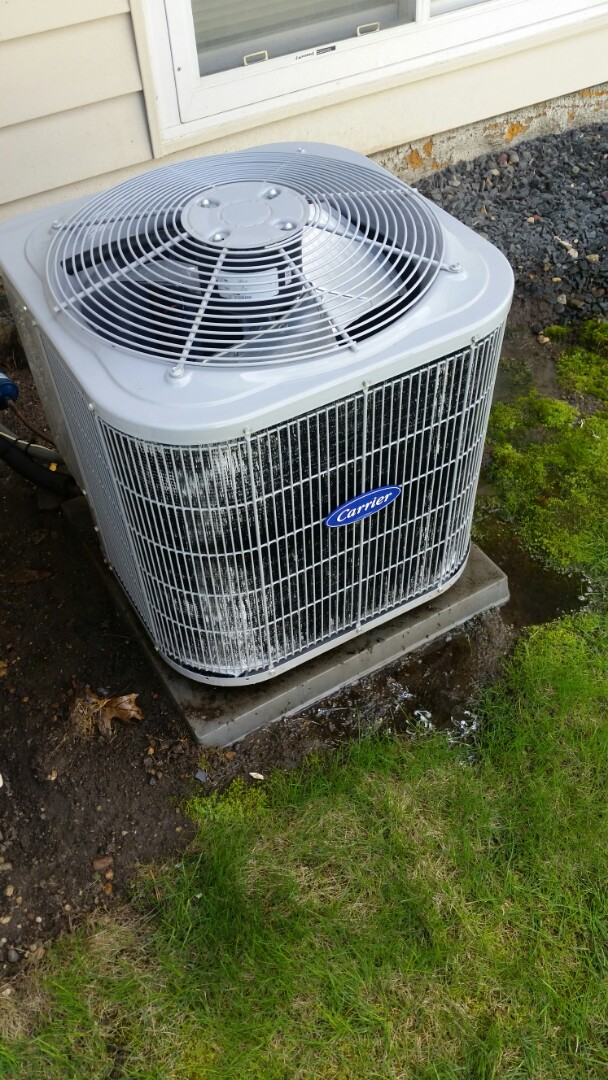 Rogers, MN - Added R410 refrigerant and leak prevention kit to Carrier A/C unit in Rogers