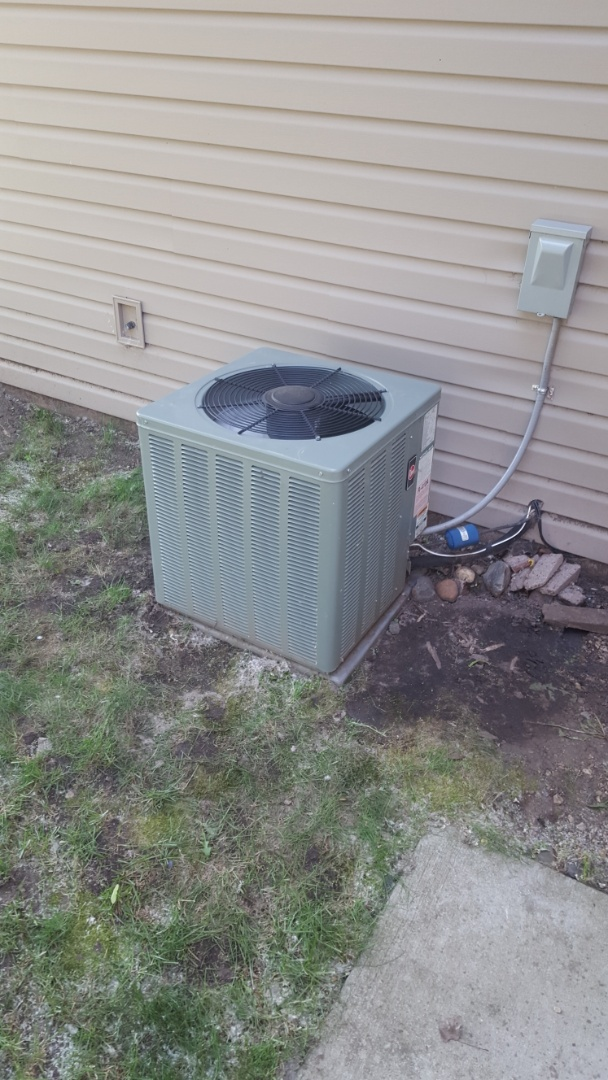 Maple Grove, MN - AC service. Installed Easy Seal leak sealant, locking caps, a capacitor, and R410a refrigerant on a Rheem air conditioner.