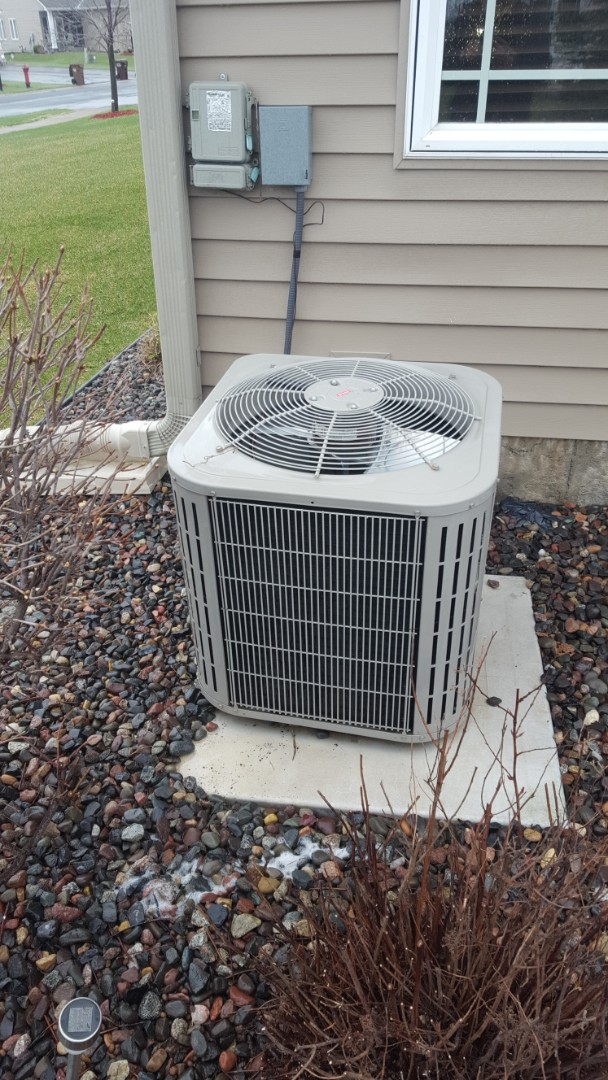 Minneapolis, MN - Air conditioning service. Installed a blower motor, blower capacitor, Honeywell media filter on a Carrier furnace and performed a cleaning and tune up on Carrier AC.