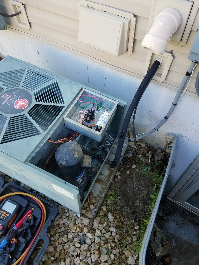 Saint Michael, MN - Rheem cooling system, not cooling. Performed ac tune and electrical upgrade. And a charge balance with leak prevention