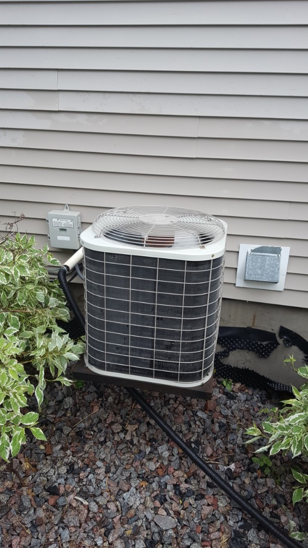 Maple Grove, MN - Air conditioner service. Installed a motor booster and performed a cleaning and tune up on a Bryant A.C.