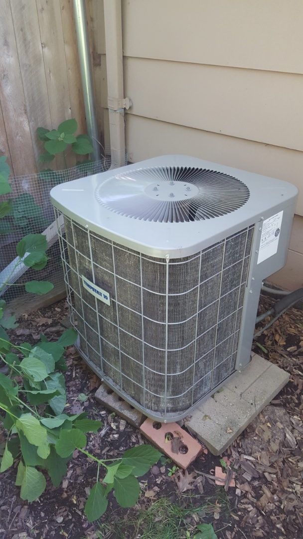 Loretto, MN - AC service. Fin combed a condenser coil on a Tempstar air conditioner.