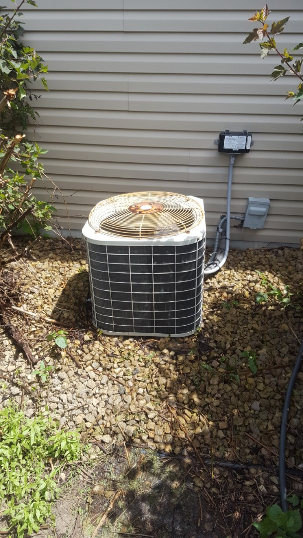 Saint Michael, MN - Air conditioning service. Installed a motor booster on a Bryant air conditioner and performed a cleaning and tune up.