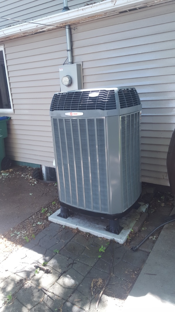 Saint Louis Park, MN - AC service. Installed a Trane thermostat and capacitor on a Trane communicating system. Also performed a cleaning and tune up on the Trane heat pump and cleaned the Trane Clean Effects air cleaner.