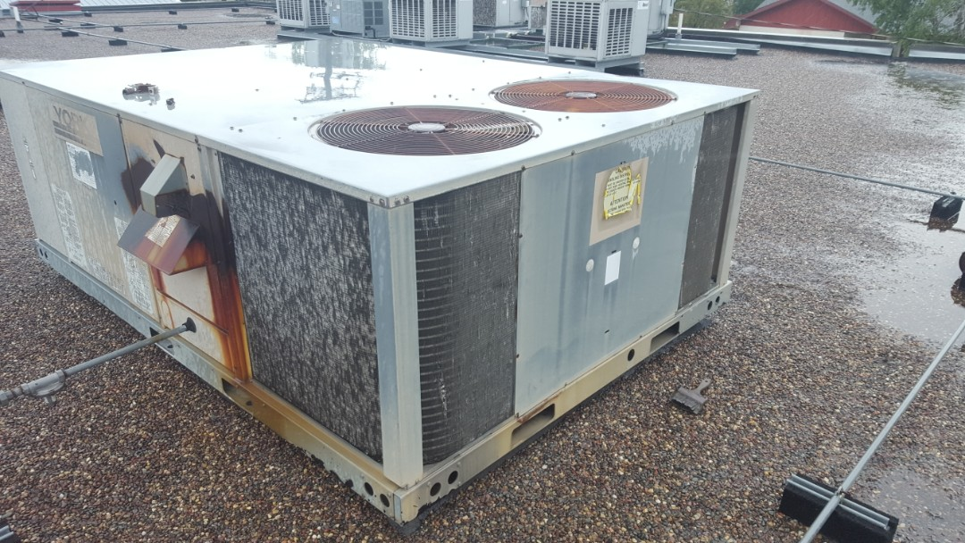 Osseo, MN - Commercial air conditioning service. Diagnosed condenser coil damage from a hail storm.