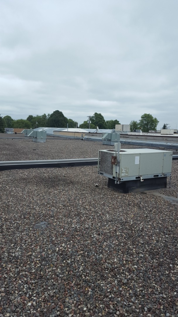 Osseo, MN - Commercial RTU service. Diagnosed multiple issues from storm damage on Bryant, Rheem, and Lennox roof top units.