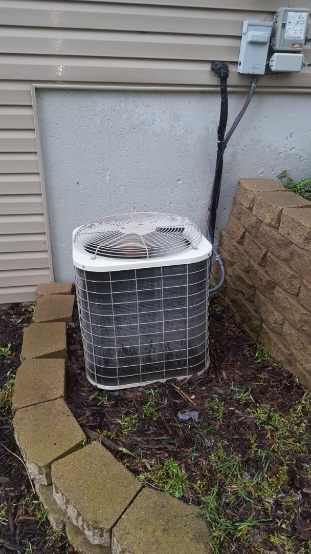 """Osseo, MN - Air conditioning maintenance. Performed a cleaning and tune up on a Bryant air conditioner and installed a 4"""" media filter."""