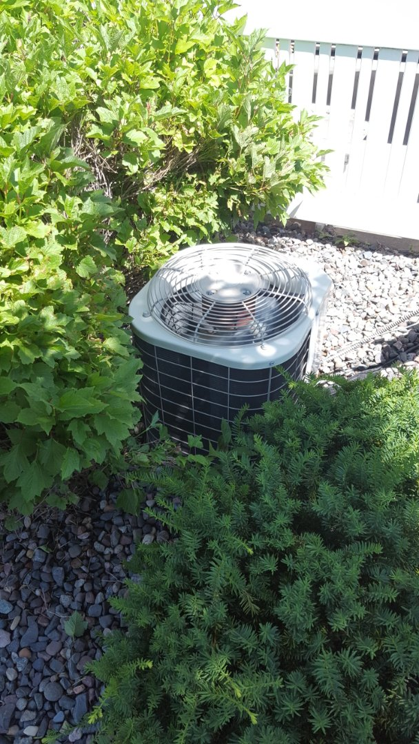 Big Lake, MN - AC service. Installed a/c leak sealant, locking refrigerant caps, and R22 refrigerant on a Bryant air conditioner and performed a cleaning and tune up.