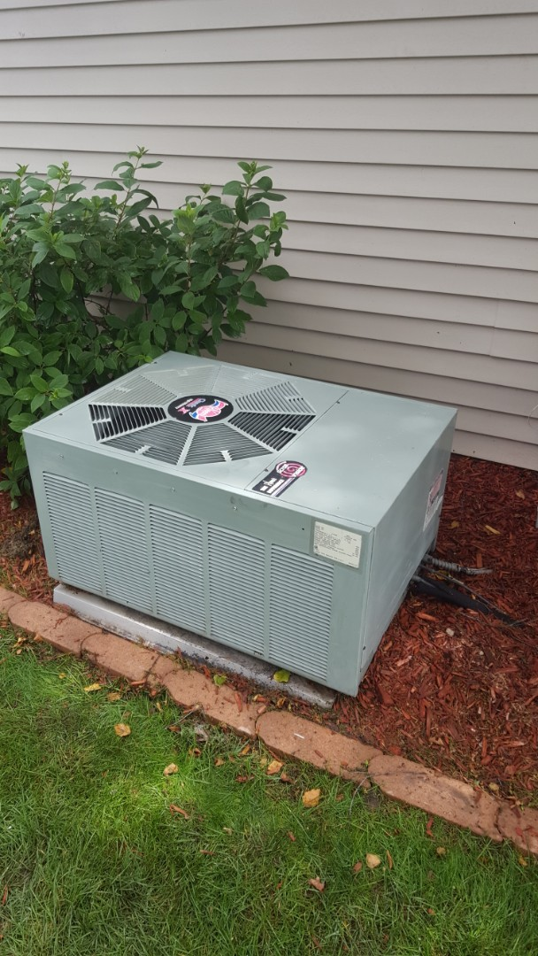 Saint Michael, MN - Air conditioner service. Installed a drain assembly, drain pan treatment and performed a cleaning and tune up on a Rheem A.C. Also performed a blower wheel cleaning on a Rheem air handler.