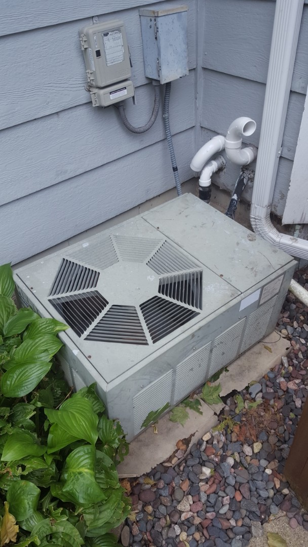 Maple Grove, MN - AC service. Installed Easy Seal a.c. leak sealant and R-22 refrigerant in a Rheem air conditioner.