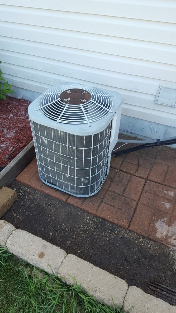 Buffalo, MN - Air conditioning service. Install a.c. sealant, locking refrigerant caps and R-22 refrigerant on a Carrier air conditioner.