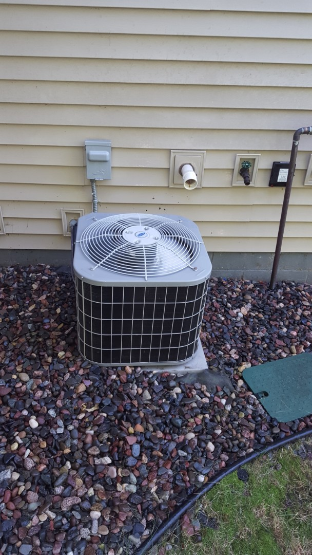Osseo, MN - AC service. Installed a Turbo 200 capacitor and performed a cleaning and tune up on Carrier air conditioner.