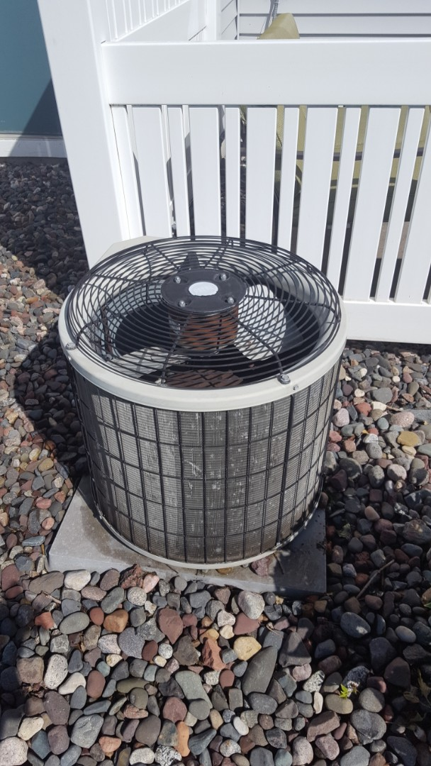 Maple Grove, MN - Air conditioner service. Performed a cleaning and tune up on a Payne air conditioner.
