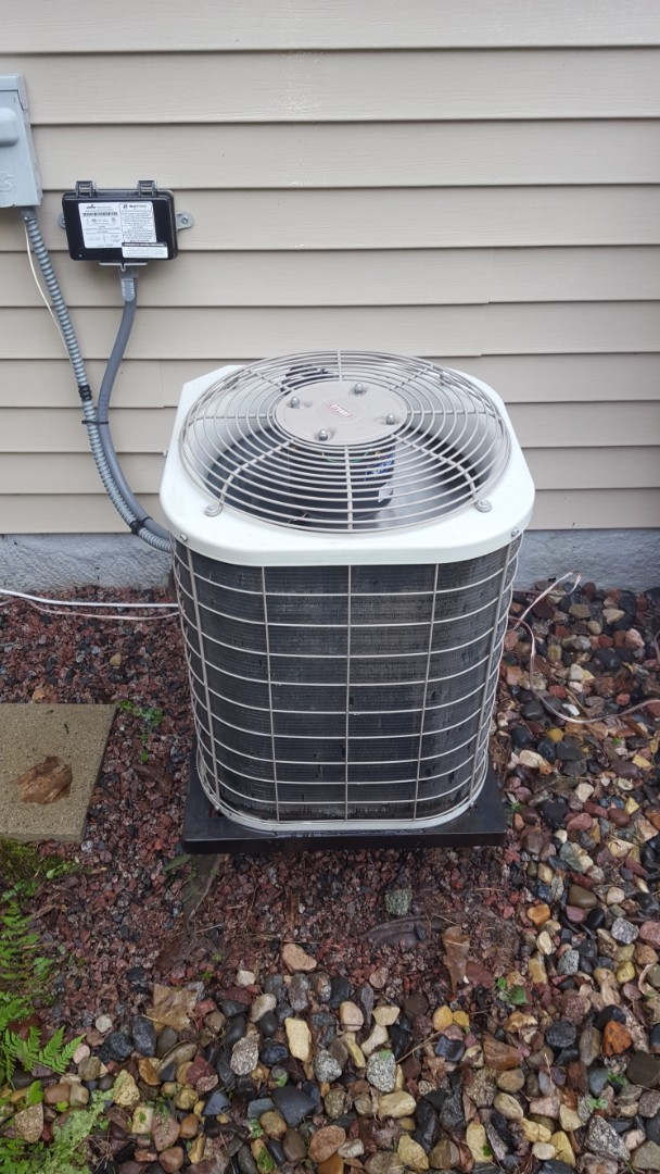 Saint Michael, MN - Air conditioning service. Installed a condenser fan motor and performed a cleaning and tune up on a Bryant air conditioner.