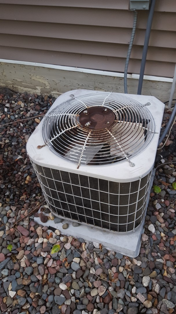 Plymouth, MN - A/C service. Installed a capacitor on a Carrier air conditioner.