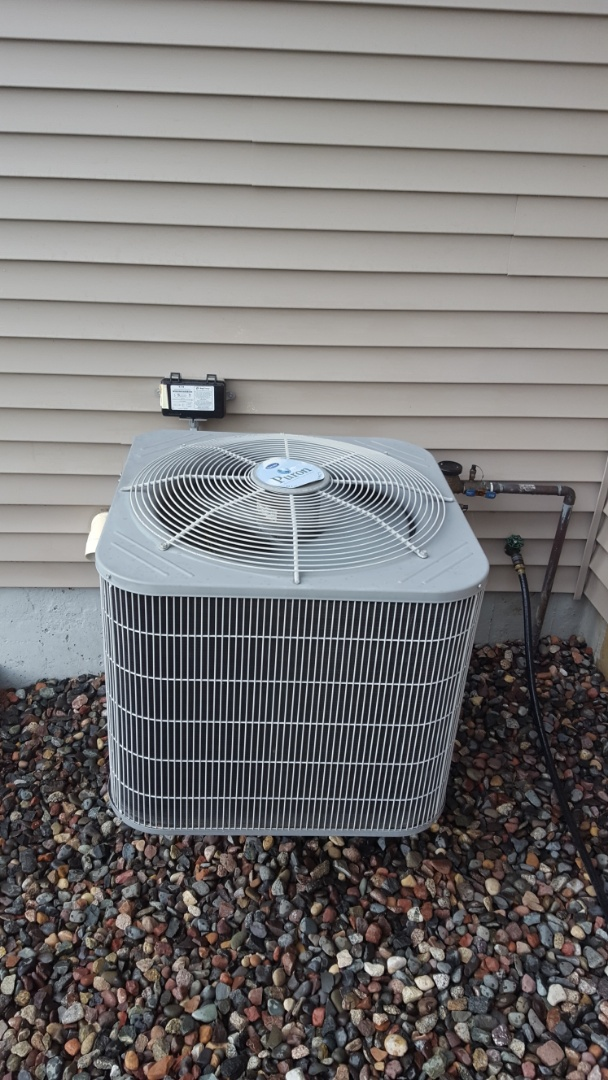 Saint Michael, MN - Air conditioner service. Installed a.c. leak sealant, locking refrigerant caps, and R410A refrigerant. Also performed a cleaning and tune up on Carrier air conditioner.