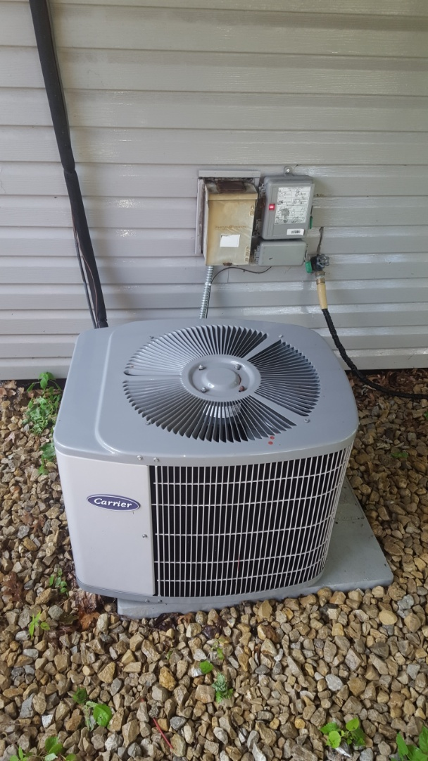 Elk River, MN - Air conditioning service. Performed a cleaning and tune up and installed a capacitor on a Carrier air conditioner.