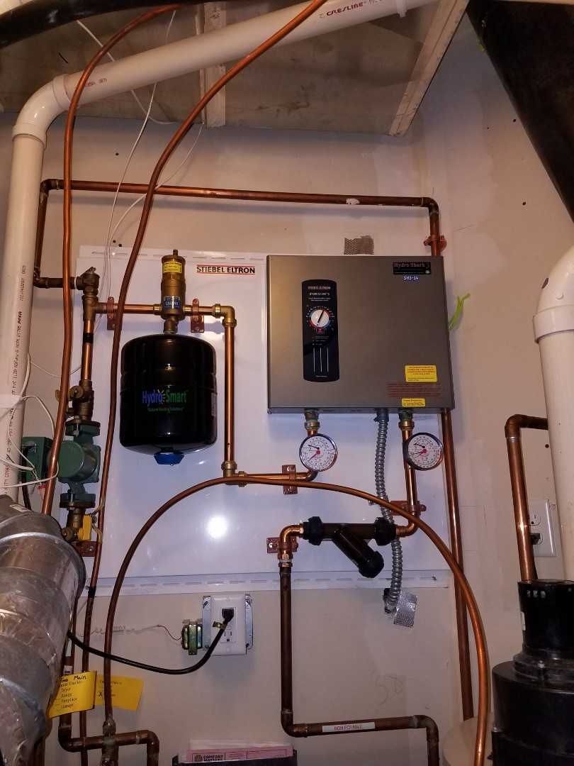 Delano, MN - In floor heat service. Purged an electic Hydro Shark3 boiler and filled to correct pressure.