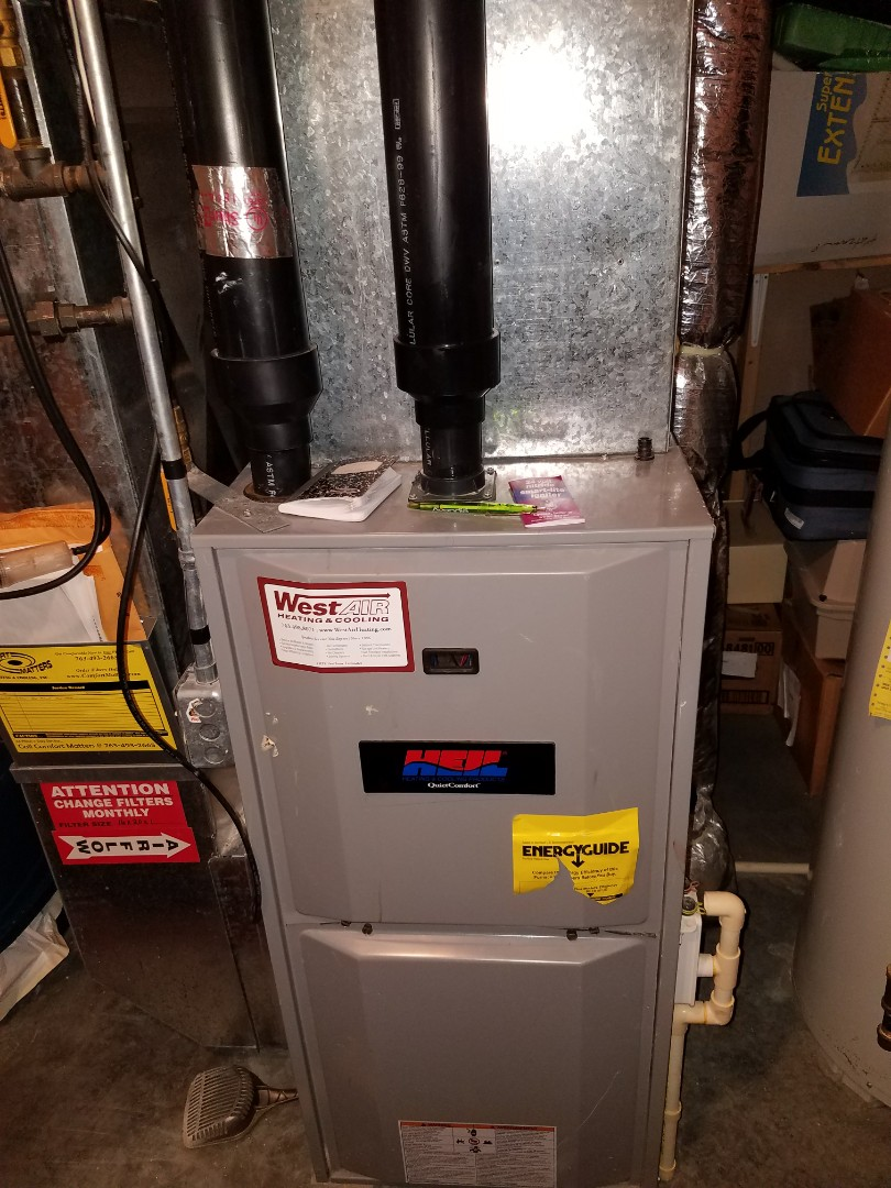 Hanover, MN - Furnace tune up and pilot assembly cleaning on 90% Heil unit in Hanover.