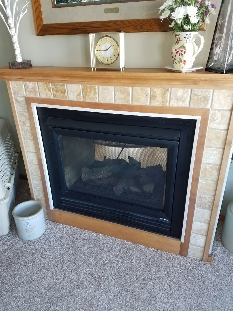 Hanover, MN - Fireplace service. Diagnosed a failed thermostat and switch on a Heat-N-Glow fireplace.