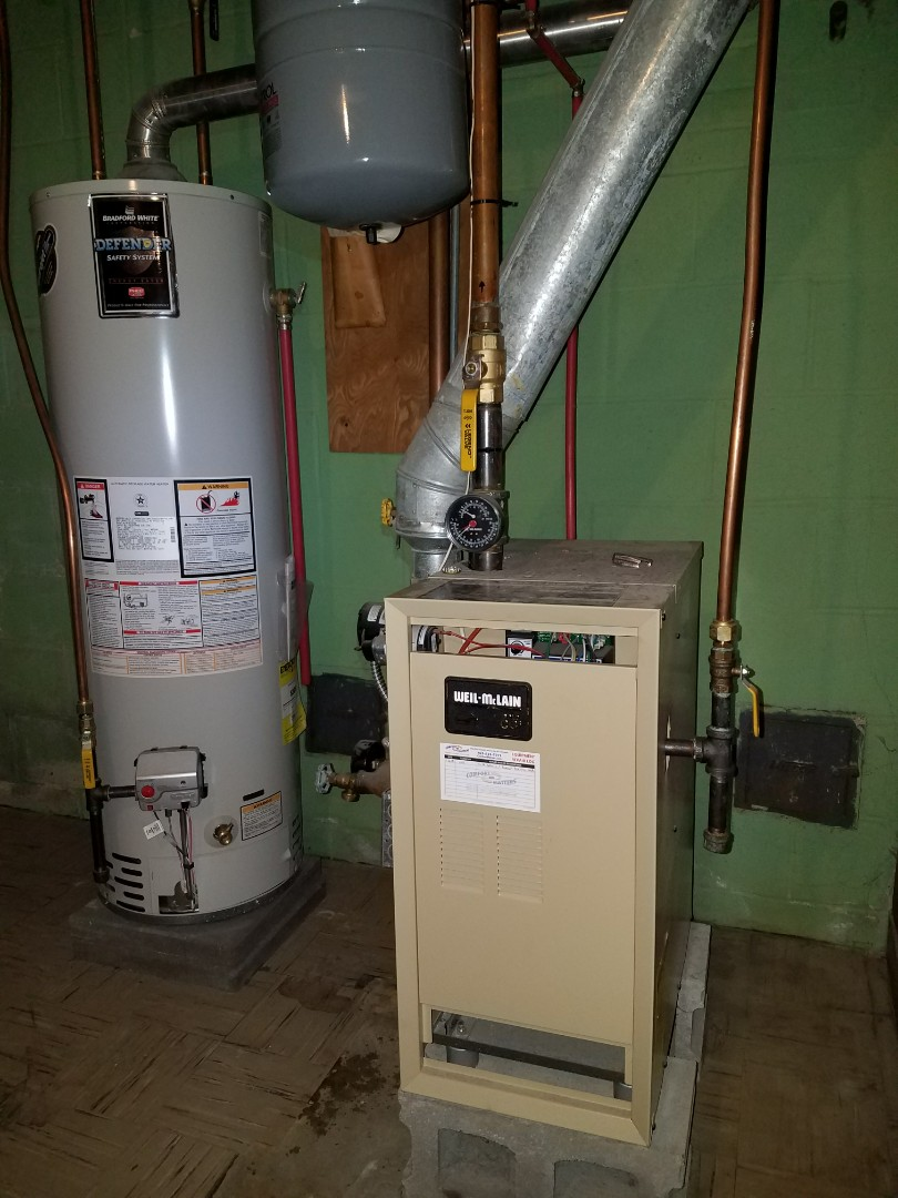 Delano, MN - Boiler repair. Installed two Honeywell zone valve actuators on a Weil-McLain boiler system.