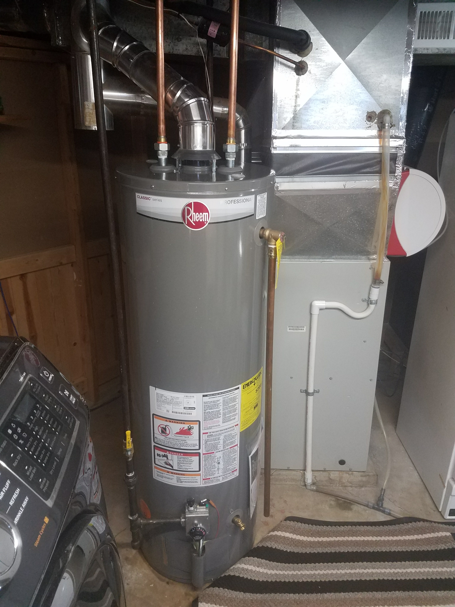 Coon Rapids, MN - Installed Rheem water heater