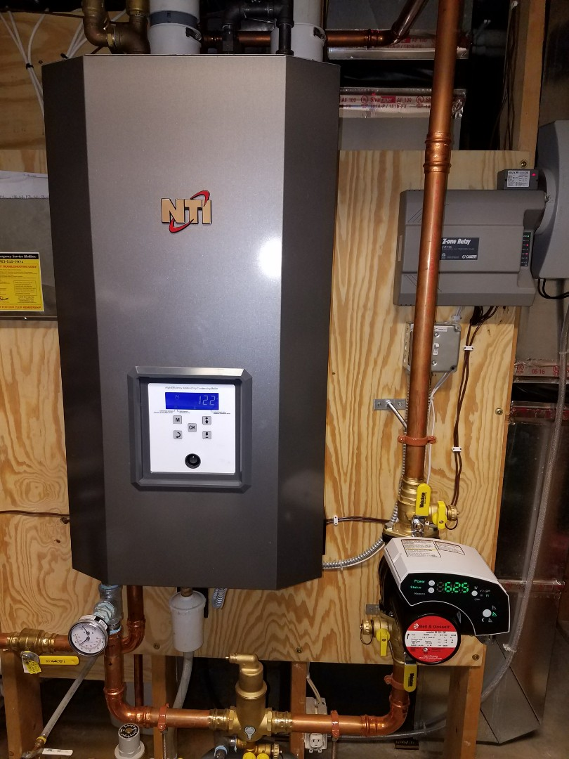 Loretto, MN - Heating service. Installed a blower assembly and gas valve on a NTI boiler.