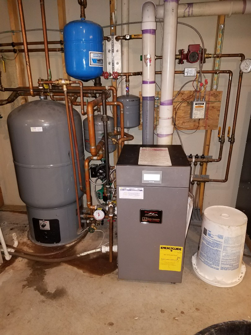 Rogers, MN - Heating service. Installed a backflow preventer, expansion tank, pressure and temperature gauge,  and a pressure safety relief valve. Also performed a cleaning and tune up on a Burnham boiler and a Venmar air exchanger.